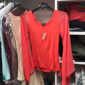 Bebe NWT top with wide sheer sleeve sz S